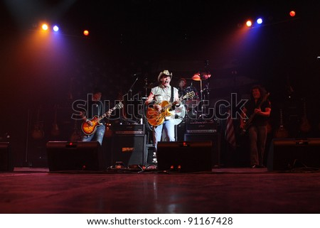 PHOENIX, AZ - JUNE 28: The Ted Nugent band, Derek St. Holmes (left) Ted Nugent (center) and Greg Smith (right) perform for fans at the Celebrity Theatre in Phoenix, Arizona on June 28, 2011.