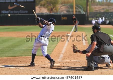 PHOENIX, AZ - OCTOBER 19: New York Yankees prospect Ronnier Mustelier bats for the Phoenix Desert Dogs in the Arizona Fall League Oct. 19, 2011 at Phoenix Municipal Stadium in Phoenix, AZ. Mustelier went 2-for-4. - stock photo