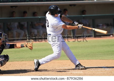 PHOENIX, AZ - OCTOBER 19: Rob Segedin, a High-A New York Yankees prospect, bats for the Phoenix Desert Dogs in an Arizona Fall League game Oct. 19, 2011 at Phoenix Municipal Stadium, Phoenix, AZ. - stock photo