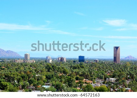 Phoenix downtown against east valley mountains, AZ - stock photo