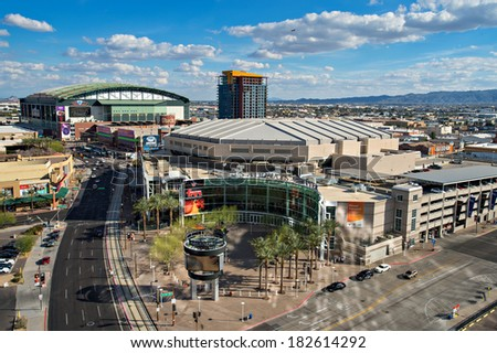 PHOENIX, USA - FEBRUARY 4: View of US Airways Center & Chase Field on February 4, 2014. Chase Field is the home of the Diamondbacks.  US Airways Center is the home of the Suns, Mercury, and Rattlers. - stock photo