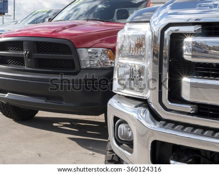 Phoenix, USA - January 08, 2015: close up of Ford and Dodge pick-up trucks. - stock photo