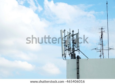 Phone Antennas on terrace with blue sky and white cloud is background