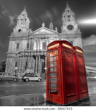 Phone booths in front of St Paul's Cathedral in London - stock photo