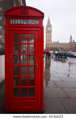 Phone box and Big Ben on a rainy day, London England - stock photo