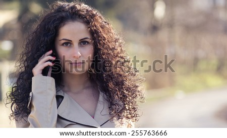 Phone call / Beautiful girl talk with someone.Close up portrait. To the image is some light and color effects  and fine film noise added - stock photo