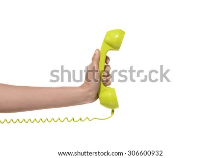 Phone call. Hand holding a green phone. - stock photo