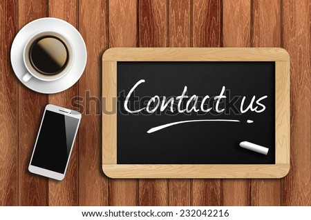 Phone, Coffee And A Chalkboard On The Wooden Table Written Contact Us. - stock photo