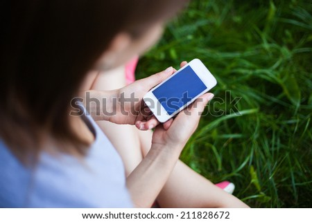 phone in the hands of girl. - stock photo