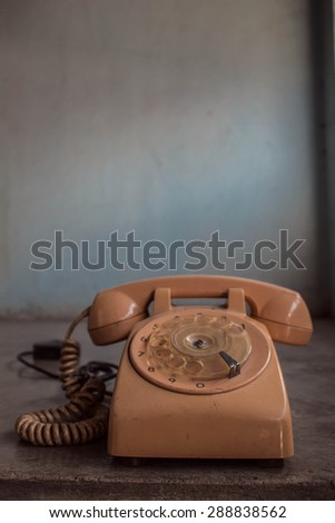 Phone old on concrete background with of vintage - stock photo