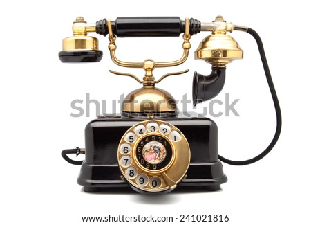 phone retro with golden parts - stock photo