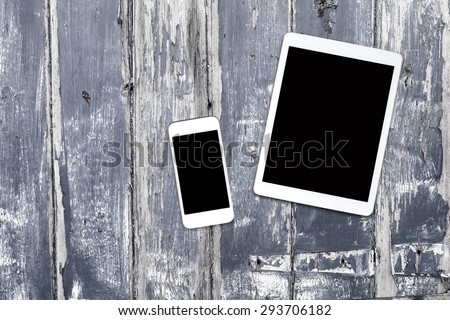 phone tablet computer on a wooden table - stock photo
