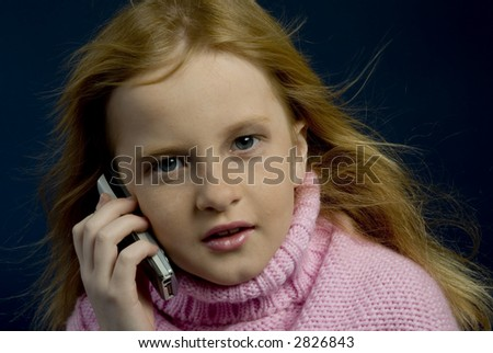 Phonecall by a little girl - stock photo
