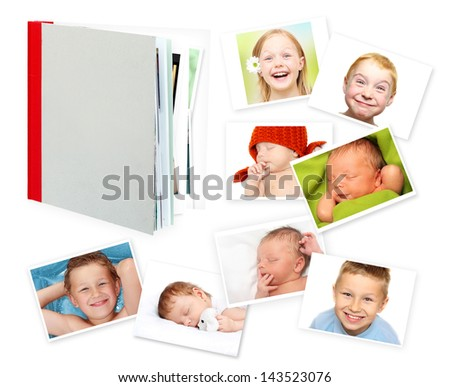 Photo album, book and photos against a white background - stock photo