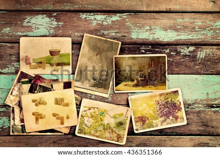 Photo album of wine on old wood table. instant photo of vintage camera - vintage and retro style - stock photo
