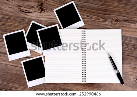 Photo album with several blank polaroid style instant photo prints.  Space for copy.  - stock photo