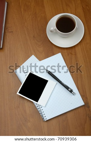 Photo and cup of coffee - stock photo