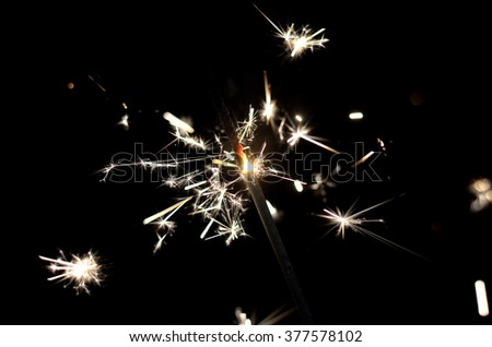 Photo Bengal fire close-up. Bright lights. Celebrate with a sparkler. - stock photo