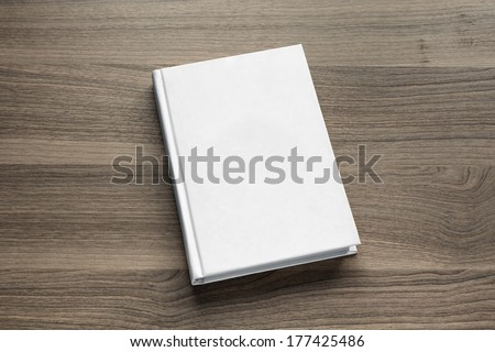 Photo blank book cover on textured wood background - stock photo