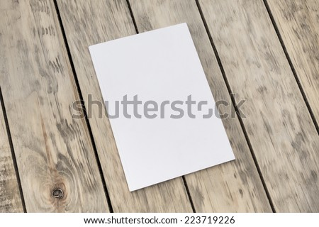 Photo blank brochure cover on textured wood background - stock photo
