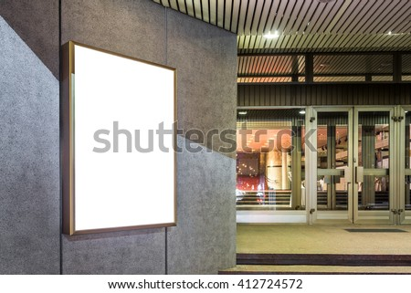 Photo blank mockup of event poster lightbox  glowing on concrete wall at night - stock photo