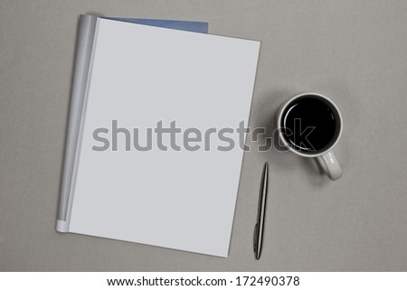 Photo. Blank open magazine isolated on textured background with pen and cup of coffee