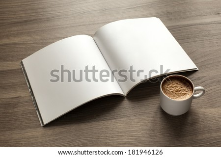 Photo blank. Open square format brochure on a wooden table and coffee - stock photo