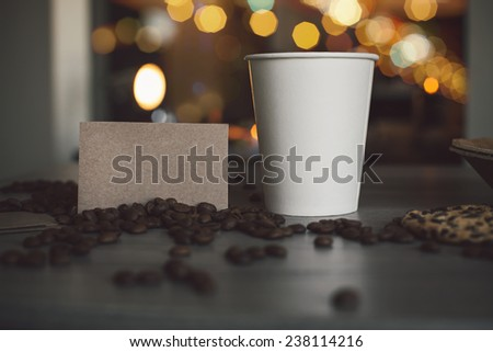Photo blank paper cup of coffee and business card coffee shop for the application logo - stock photo