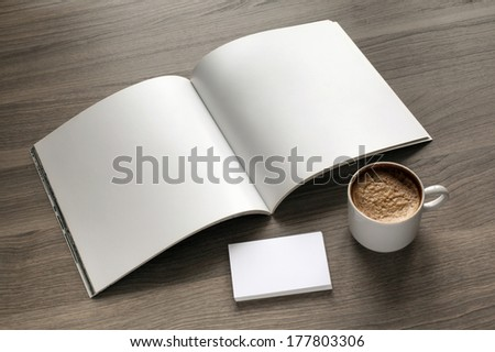 Photo blank set. Open square format brochure, b-card and cup of coffee on a wooden table - stock photo