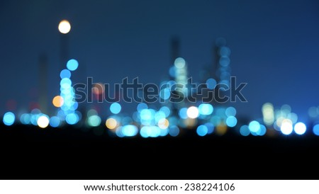 Photo bokeh of oil refinery factory at twilight - stock photo