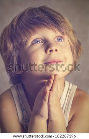 Photo boy at prayer - stock photo