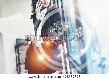 Photo business woman wearing black suit,talking smartphone and holding papers hands.Open space loft office.Panoramic windows background.Connections world wide interfaces.Horizontal,flares.Film effect - stock photo