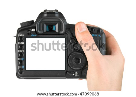 Photo camera in hand isolated on white background - stock photo