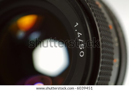 Photo Camera Lens. Close-up. Very Shallow Depth of Field. - stock photo