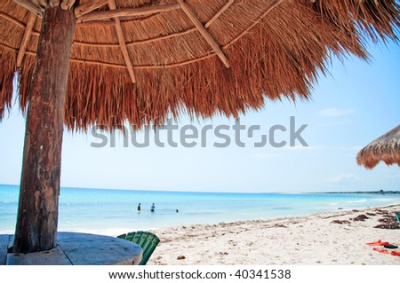 photo capture of a beach front with sand and water - stock photo