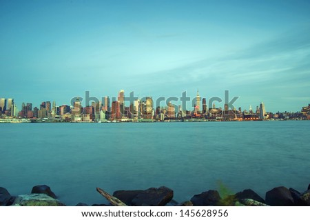 photo capture of new york city skyline at evening - stock photo