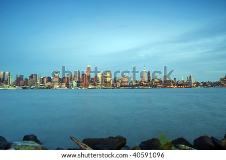 photo capture of new york city skyline at evening