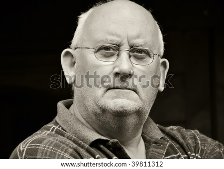 photo capture portrait of a senior male in glasses - stock photo