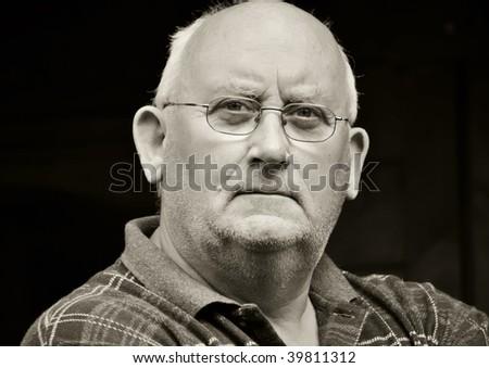photo capture portrait of a senior male in glasses - stock photo