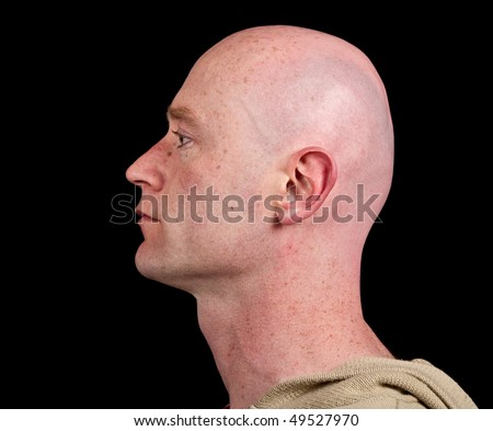 photo close up picture of a male head from side on black - stock photo