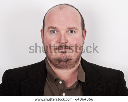 photo close up portrait of middle age male on off white backdrop - stock photo