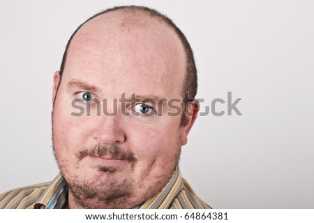 photo close up portrait of middle age male on off white backdrop