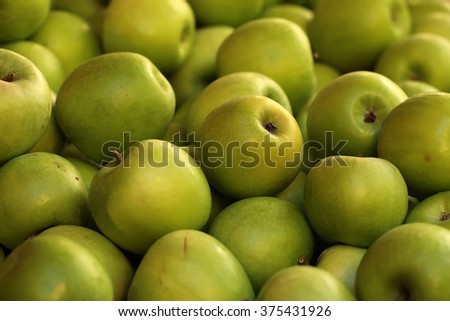 Photo closeup many clean natural organic fresh tasty ripe yellow apples crop fruit full of vitamin for healthy eating diet ball form for sale on blurred background, horizontal picture - stock photo