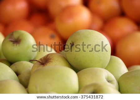 Photo closeup many clean organic natural fresh tasty ripe yellow apples and oranges crop fruit full of vitamin for healthy eating diet ball form for sale on blurred background, horizontal picture - stock photo