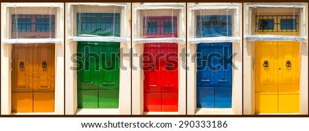 photo collage of five colourful front doors to houses - stock photo