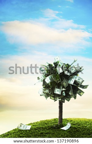 Photo composite of money tree with 100 dollar bills - stock photo