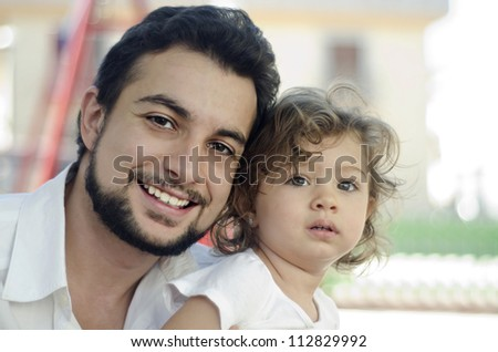 Photo concept of caring for a father to a daughter and complicity. - stock photo