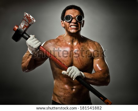 photo crazy frenzied chopper  butcher man  on dark grey background,  action with big axe  - stock photo