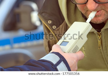 photo depicting clinical tests trzezewosci state driver by a policeman - stock photo