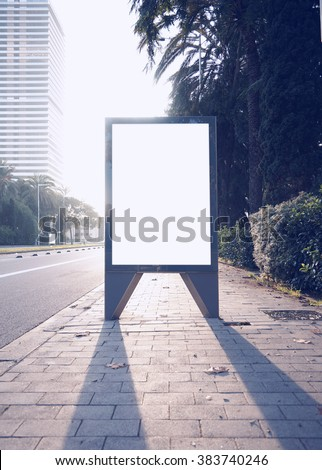 Photo empty lightbox on the bus stop. Vertical mockup, sunlight - stock photo